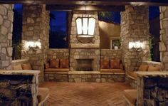 Stone covered patio with built in fireplace and seating