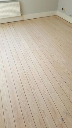 Brighton floor sanding, white wash stained pine by Btown Flooring.