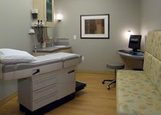 Several family members can be accommodated on the built-in seat without cumbersome guest chairs. The physician can converse with the patient and family while seated at the computer desk. All exam rooms are same-handed, with physician access from the patient's right side.