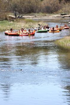 A large group of paddlers float down the Upper Truckee River Friday afternoon. Adam Jensen / Tahoe Daily Tribune