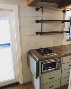 This home has a combination of electric oven and gas cooktop. Live edge counter and reclaimed wood shelves make this kitchen a must see. Stay tuned for a video walk through. #timbercrafted #tiny #home #beautiful #kitchen #love #tinyhouse #photooftheday #happy #tinyliving #instagood #follow #me #handcrafted #tinyhousemovement