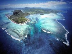Mauritius / What you're witnessing, that looks like an underwater waterfall, is actually sand from the shores  being driven via ocean currents off of that high, coastal shelf, and down into the darker ocean depths off the southern tip of the island.