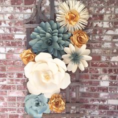This collection of handmade paper flowers will make a wonderful wall decor in the home, office, shop, nursery or retail shop space