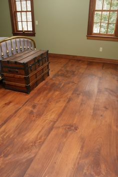 Wide Pine Floor Boards Authentic wide plank pine flooring in the bedroom of a historic Rhode Island home, Eastern White Pine, premium grade, with custom stain mix and tung oil matte finish.