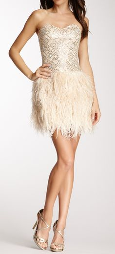 Sequined + feathers... cute reception dress