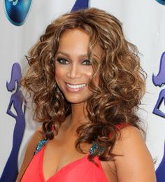 I am thinking of a curly weave.  some ideas!!