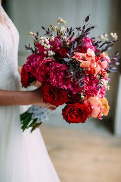 deep red bouquet - photo by Cluney Photo http://ruffledblog.com/cinco-de-mayo-wedding-inspiration-with-macrame #flowers #bouquets #weddingbouquet