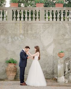 This beautiful wedding venue was filled with wedding greens and backdrops that were rustic, traditional, and unique. Click to see more greenery Italian wedding inspiration! #Wedding #WeddingInspiration #WeddingVenue #WeddingIdeas | Martha Stewart Weddings
