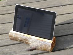 Wooden iPad holder. Handmade from alder wood. Finished with linseed oil. iPad not included.  Size : lenght 27 cm (10,6 in. )   height 6 cm (2,4 in.)