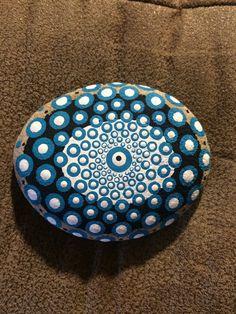 Medium sized mandala stone with extra detail. Turqoiuse, white and black.