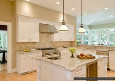 Giallo Napoli Granite with White Cabinets , Light Oak Flooring, Tumbled Travertine Subway Backsplash and Stainless Steel Appliance