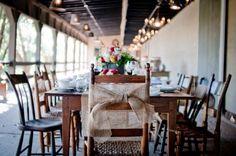 burlap bow wedding reception chairs 550x365 Rustic Fall Wedding Ideas