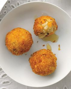 Butternut Arancini (rice, goat cheese, squash and sage, lightly fried and drizzled with honey) Fried rice balls popular in Southern Italy
