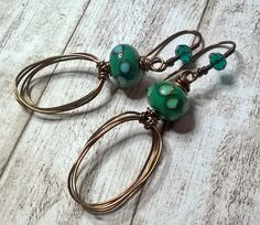 Wire wrapped earrings - green lamp work glass earrings - copper brass crystal earrings - artisan earrings - Handmade jewelry by Salakaappi by Salakaappi on Etsy