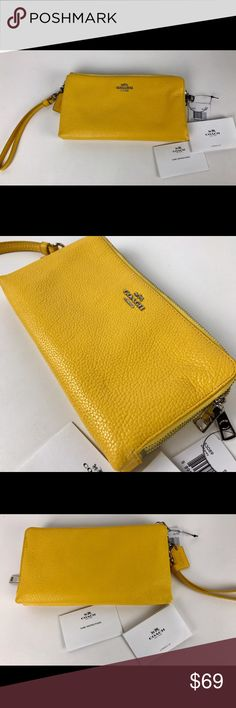 "Coach Double Zip Wallet in Yellow Pebble Leather Condition:  New with tag. A few minor marks on exterior from handling.  Crafted in lightweight leather with a delightfully pebbled texture, this slender design holds currency and credit cards on one side, a cell phone and additional personal items on the other. A detachable leather wrist strip allows for hands-free wear.  7 3/4"" (L) x 4"" (H) x 1"" (W)    Thank you for your interest! No Trades please. Coach Bags Wallets"