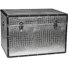 A bold metallic design on high-quality textured vinyl lights up this trunk. Silver hinges, tightly-clasping closures and durable rivets match the color of the crocodile pattern. Durable wooden construction is reinforced with riveted edges.