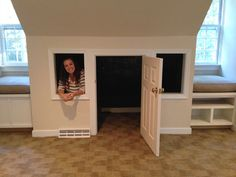 What a cool idea for an upstairs playroom - a playhouse in the nook between the windows.