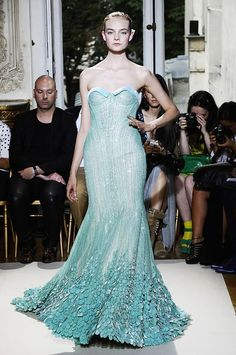 Georges Hobeika - channels the mythical mermaid, flowering out into a fan of fishscales at the bottom.