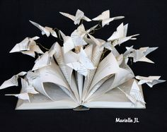 Butterfly book.... This altered book is my interpretation of this proverb, I particularly like .... : A book is like a garden carried in the pocket My idea is to transmit visually all that may contain a book ... This is not a simple object, but a small world that you can take away anywhere, and where you can take refuge ... Each butterfly is an origami. Then each paper butterfly is attached to golden lightweight iron, by this way, the slightest current of air gives them Life... And this…