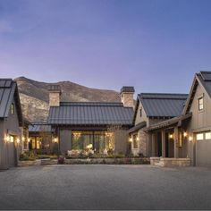 "This mountain home was designed around a centralized ""barn"" structure for easy entertaining. The ""barn"" bi-sects the floor plan with the guest suites in one wing and the master suite on the other wing. The interior design concept was to blend rustic mate Mountain Home Exterior, Modern Mountain Home, Mountain Homes, Mountain Home Plans, Modern Farmhouse Exterior, Farmhouse Design, Home Interior Design, Exterior Design, Stone Exterior"