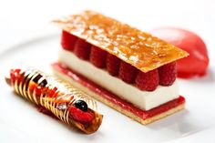 pretty sure is jaconde sponge+raspberry jam+panna cotta +raspberry+ caramel puff pastry at the top. accompany with raspberry sorbet, and sugar work with tuile