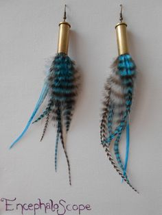 Jewelry Making Shells Feather earrings - Bullet shell jewelry - Blue, black and white - Natural grizzly rooster feathers - Long - - Bullet Shell Jewelry, Shotgun Shell Jewelry, Bullet Casing Jewelry, Ammo Jewelry, Jewelry Art, Bullet Necklace, Jewellery, Bullet Casing Crafts, Bullet Crafts