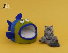 Miniature Cat sculpture with Fish Bed by Pajutee