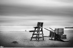 """Picture-A-Day (PAD n.2622) """"Don't Cry Uncle""""  Some just don't ever give up... prints and more: http://www.dangrabbit.com/photography/pad/09_21_dontcryuncle  Fineart photography - lifeguard chairs on beach - Long Island, New York - by Amy DangRabbit Medina"""