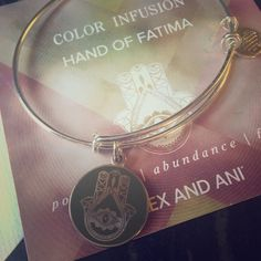 Alex and Ani Hand of Fatima Color Infusion Bangle Authentic Alex and Ani Hand of Fatima Color Infusion expandable bangle bracelet in silver. The charm is a pretty avocado green color. No signs of wear. Basically brand new. Alex & Ani Jewelry Bracelets