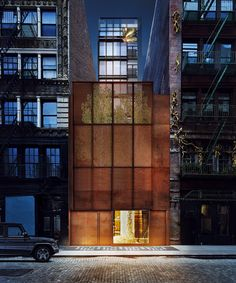 '22 bond' contains six exclusive new york residences behind a weathering steel gatehouse