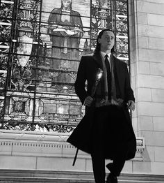 Loki in a suit coolly walking down the steps, plotting chaos... (God of Lies and Chaos)