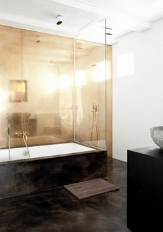 stunning! the metallic wall and doorless shower feel light, effortless and luxe