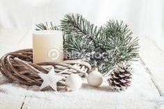 Stock Photo : Christmas decoration, candle, artificial snow, twigs, cone, baub