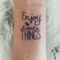 Wrist tattoo saying Enjoy the little things on...