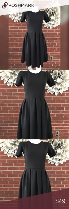 LulaRoe Solid Black Unicorn Amelia Dress Please see photos for all measure! Sorry I do not model/trade!! This item comes from a smoke free, pet friendly home!! No rips, holes or stains to note!! I ship Monday-Friday to ensure quick delivery (orders placed after 7am will not be processed until the following day). Orders placed Saturday/Sunday will not be processed until Monday morning :)! Thanks for shopping my closet! AP51 LuLaRoe Dresses Midi