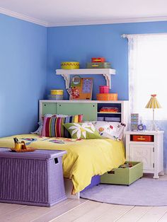All-Around Storage - The secret to this storage-packed girl's bedroom is providing lots of organization space without making things look cluttered. Underbed drawers and hidden headboard shelves store items inconspicuously. Other storage items, like this bedside table and purple bin, coordinate with the decor for a cohesive, clutter-free look.