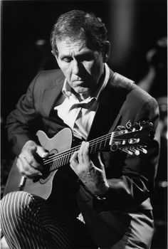 Chet Atkins-Mr Guitar! I grew up listening to Chet Atkins, my father plays guitar just like him.