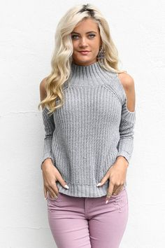 6d992c3b8d96 Warm and cozy thick knit sweater top features mock neck and cold shoulders.  Material is Cotton and Spandex Model Megan is wearing Small Bust Length  Small M