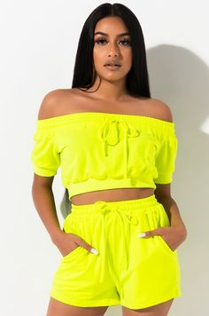 Off shoulder, neon cropped sweatshirt by AKIRA. Swag Outfits For Girls, Neon Outfits, Cute Comfy Outfits, Fashion Outfits, Crop Top Sweater, Crop Top And Shorts, Long Sleeve Crop Top, Crop Tops, Neon Crop Top