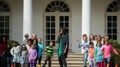 First lady Michelle Obama blows a whistle to start an obstacle course race in the Rose Garden of the White House in Washington, Monday, March 28, 2016, during the White House Easter Egg Roll. Thousands of children gathered at the White House for the annual Easter Egg Roll. This year's event features  live music, sports courts, cooking stations, storytelling, and Easter egg rolling. (AP Photo/Andrew Harnik)