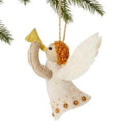 Angel Felt Holiday Ornament - Silk Road Bazaar (O) Women in Kyrgyzstan made this ornament by hand from felt. With a loop for hanging and accented with sequins and beads, the ornament measures 5.5 inches tall.