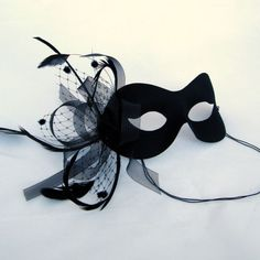 Different color obviously, but we can get a nice mask for Courtney (and us who want to buy our own too) Black Birdcage Veil  Masquerade Masked Ball Mask. $39.99, via Etsy.