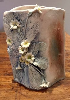 Handcrafted slab vase with Primula flower detail; made from porcelain clay Hand Built Pottery, Slab Pottery, Pottery Vase, Ceramic Pottery, Thrown Pottery, Ceramic Clay, Porcelain Ceramics, Ceramic Bowls, Keramik Design