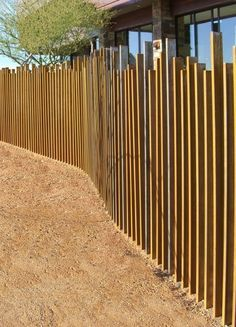 Wooden fence/screen by Suzman & Cole Design Associates (Scottsdale fence line)... I could totally make this.