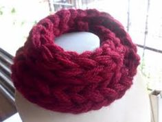 Finger-knitting like a turtleneck scarf.