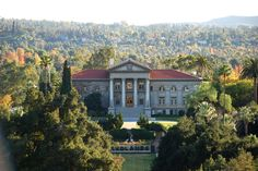 """The iconic University of Redlands administration building sits upon what first president Jasper Newton Field called """"Inspiration Hill."""" Built in it is a favorite spot on campus, due to a breathtaking view from the front steps. Hotel California, California Dreamin', University Of Redlands, Projects For Adults, Front Steps, Throughout The World, Palm Trees, Mansions, House Styles"""