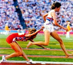 South African barefoot runner Zola Budd and Mary Decker. Controversy raged as Decker was apparently tripped by Budd, causing her to fall and unable to complete the race.  Amid boos from the crowd, Budd fell to 7th place.  1984 Olympics, The Coliseum, Los Angeles.