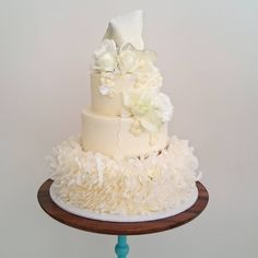 """White wedding cake, sans colour. The first time we've styled a cake like this!"""