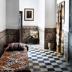Tiled walls... the effect feel like in a re mote village, how about stencile a room like so?