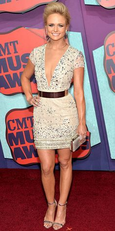 Emergency plane landings can't keep Video of the Year nominee Miranda Lambert from shining bright on her big night. The country star takes the plunge in a sparkly mini dress, while also going to great heights with a soft pompadour.     http://www.people.com/people/gallery/0,,20823101,00.html#30167403
